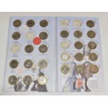 Twenty four £2 coins in a 'Great British Coin Hunt' folder, includes Manchester Commonwealth Games