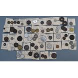 A collection of world coins contained in old hand written slips, largely 19th and early 20thC,