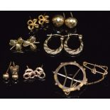 A collection of 9ct gold earrings including hoop , faceted, clover, bow, etc and a 9ct gold mount,