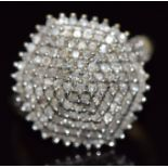 A 9ct gold ring set with diamonds in a large cluster, 4.1g, size P
