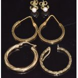 A pair of 9ct gold rings set with a pearl to each, a pair of 18ct gold hoop earrings (2.1g) and