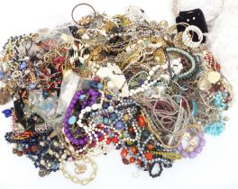 A collection of costume jewellery including vintage brooches, beads, necklaces, etc