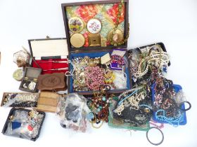 A collection of costume jewellery including vintage necklaces, beads, mother of pearl box, wooden