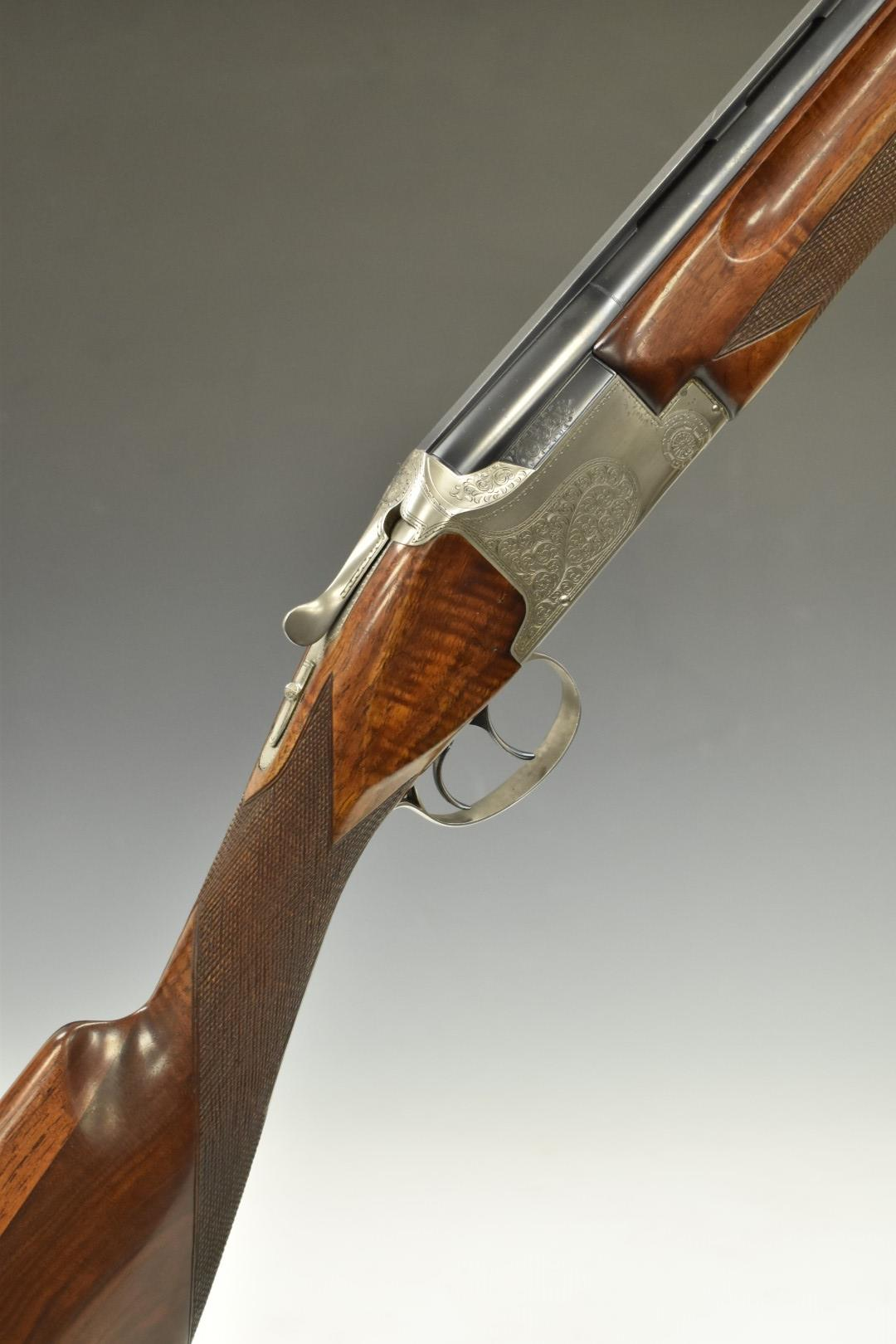 Winchester Super Grade 12 bore over and under ejector shotgun with engraved locks, trigger guard,