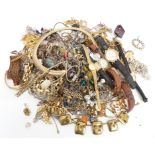 A collection of costume jewellery including chains, necklaces, watches, brooches, etc