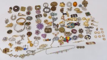 A collection of vintage brooches including enamel, paste, etc
