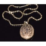 Victorian 9ct gold necklace/ chain (40cm long) and a yellow metal Victorian locket with engraved