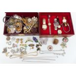 A collection of costume jewellery including filigree pendant, 9ct gold pendant, Sarah Coventry