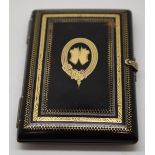 Tortoiseshell pique work purse having gold and silver inlaid decoration including coat of arms to
