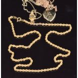 Three 9ct gold necklaces/chains, a 9ct gold clown pendant and a 9ct gold heart padlock, 13g