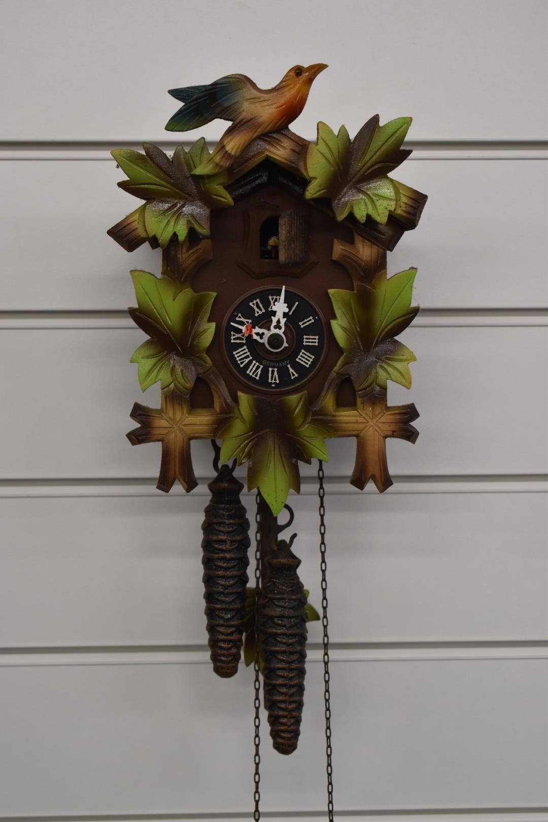 A c1970s two train cuckoo clock in painted case, with two weights, H22cm