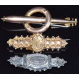 A 9ct gold Royal Navy brooch in the form of a torpedo and lifebuoy, 9ct gold brooch (5.3g) and a