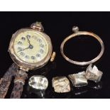 A 9ct gold watch, gold teeth and 9ct gold mount (10.8g)