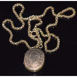 A 9ct gold Victorian necklace (10g) and rolled gold locket with engraved decoration