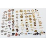A collection of jewellery including silver rings, Hollywood brooch, Czech buckle, Miracle pendant,