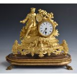 19thC French figural mantel clock featuring a seated artist, the 8cm enamelled dial marked Jay