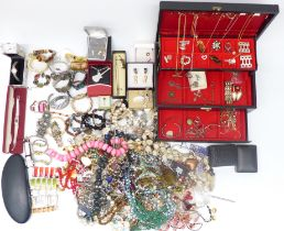 A collection of costume jewellery including silver locket, silver earrings, bangles, bracelets, etc