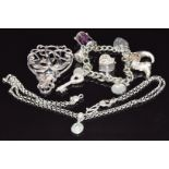 Art Nouveau silverbrooch (Birmingham 1901), silver charms, and a silver necklace by OMG