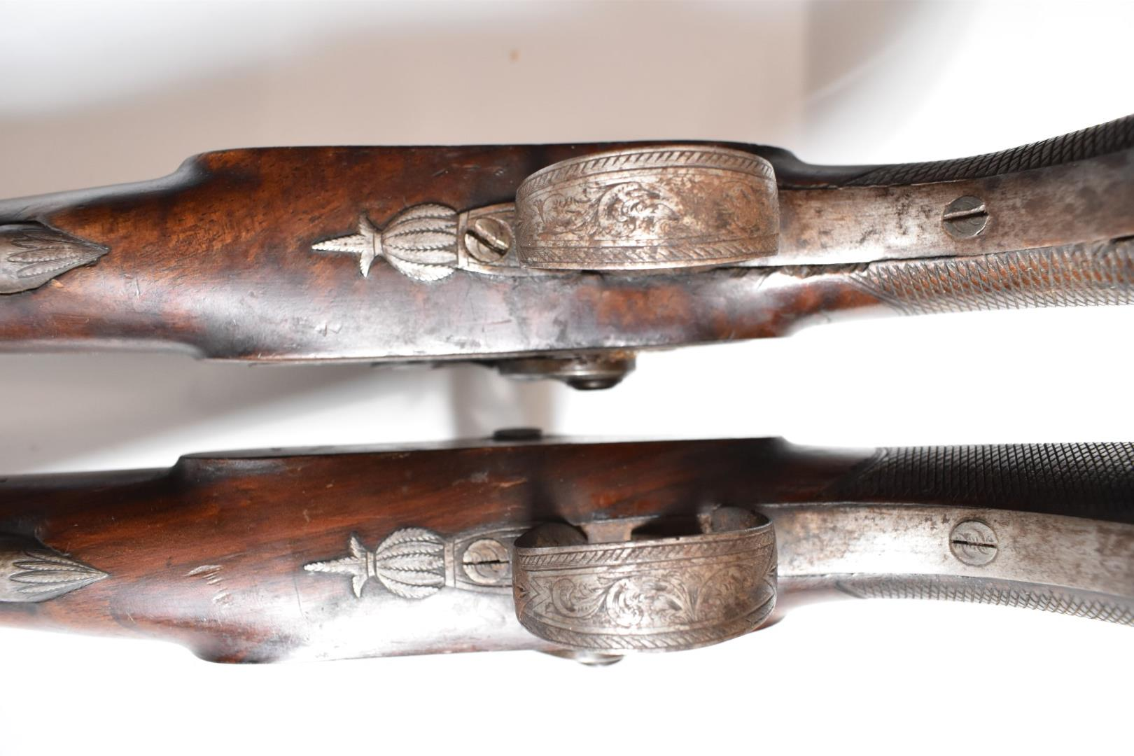 A pair of percussion hammer action pistols with locks signed 'Backwell Devonport', ornately engraved - Image 10 of 11