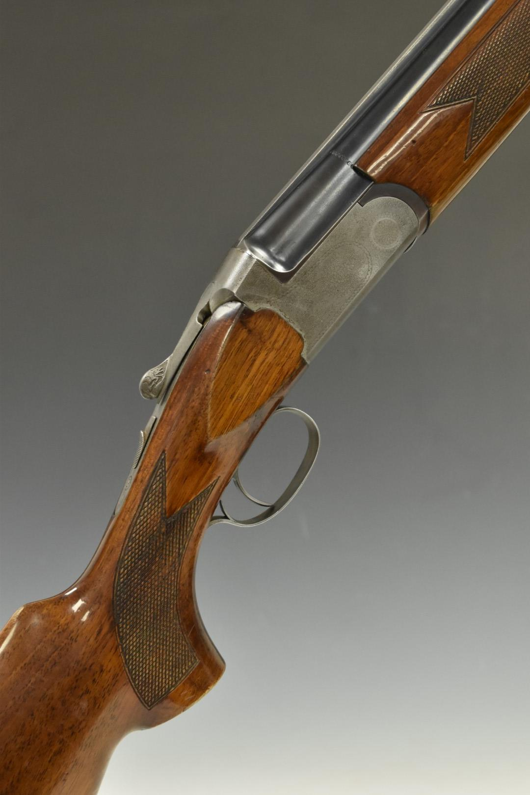 Sportarmi 12 bore over and under shotgun with engraved locks, underside, top plate and thumb