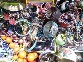 A collection of costume jewellery including bangles, necklaces, etc