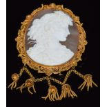 A c1860 gold filigree brooch set with a large cameo of a young woman, with tassel decoration, 5.5