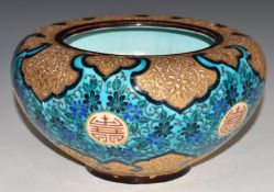 A continental pedestal bowl with enamelled and gilt Chinoiserie decoration, indistinct impressed