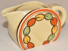 Clarice Cliff for Newport Pottery Art Deco cream jug in the Oranges and Lemons pattern, H6.5cm