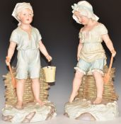 A pair of continental bisque figures of children paddling on a beach, impressed marks verso, H41cm