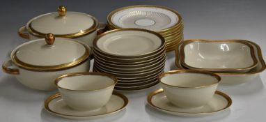 Approximately 52 pieces of German Huthenreuther porcelaindinner service with floral gilt border