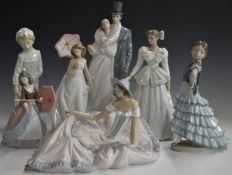 Six Lladro and Nao figures including sweethearts, girls with parasols etc