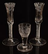 A pair of mid-18thC air twist stem glasses, the bowls etched with roses of Jacobean significance,