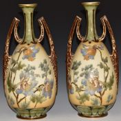 A pair of Vienna twin handled pedestal vases with tube lined decoration of Meconopsis / Himalayan