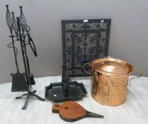 Art Nouveau copper covered coal scuttle, foot scraper, Arts & Crafts companion set and a fire guard