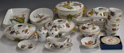 Approximately twenty five piecesof Royal Worcester oven and dinner ware decorated in the Evesham