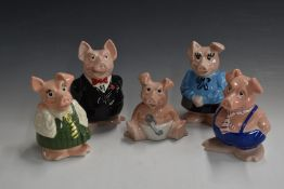Set of Wade Nat West pigs, in original packaging (dated 1991)