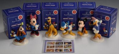 A collection of Royal Doulton Walt Disney 70th Anniversary figures