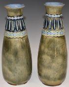 A pair of Royal Doulton pedestal bottle vases, H21cm
