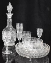 A large suite of cut drinking glasses and dessert bowls with hand etched Greek key design in the