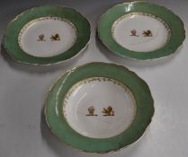 Three 19thC armorial plates with lion and possibly Turkish bust decoration, diameter 26cm