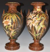 A pair of Watcombe South Devon pedestal twin handled vases decorated with birds and flowers, H34cm