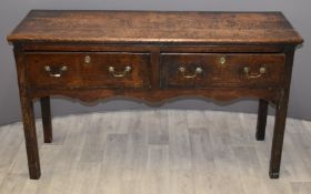 Early 19thC country oak sideboard with three drawers and shaped front stretcher, W137 x D46 x H79cm