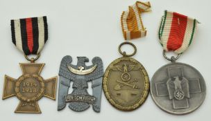 Two German WW2 Third Reich Nazi medals comprising Atlantic Wall and Volkspflege examples together