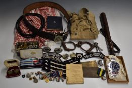 Palestine Police ephemera including leather belt with buckle, truncheon, handcuffs, buttons of