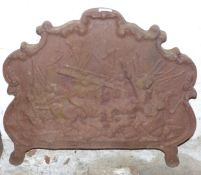 Antique cast iron fireback with relief decoration of mounted riders in a battle scene, Fladbury