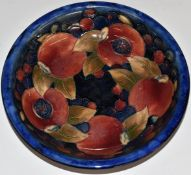 Moorcroft pedestal dish decorated in the Pomegranate pattern with two open pomegranates, H5 x D20.