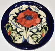 Moorcroft charger decorated in the Poppy pattern, D26cm