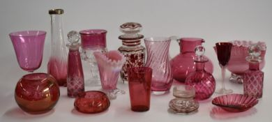 A collection of cranberry glass including enamelled, cut glass, and silver mounted examples, largest