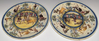 Pair of 19thC Spanish chargers decorated with bullfighting scenes, diameter 36.5cm