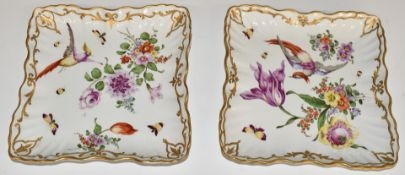 A pair of Chelsea style shallow dishes with bird of paradise decoration, impressed and gilded anchor